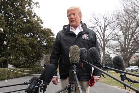 FILE PHOTO: U.S. President Donald Trump talks to reporters as he departs to visit storm-hit areas of Alabama from the White House in Washington, U.S., March 8, 2019. REUTERS/Jonathan Ernst/File Photo