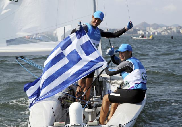 2016 Rio Olympics - Sailing - Final - Men's Two Person Dinghy - 470 - Medal Race - Marina de Gloria-Rio de Janeiro, Brazil - 18/08/2016. Panagiotis Mantis (GRE) of Greece and Pavlos Kagialis (GRE) of Greece celebrate winning bronze medal. REUTERS/Benoit Tessier FOR EDITORIAL USE ONLY. NOT FOR SALE FOR MARKETING OR ADVERTISING CAMPAIGNS.