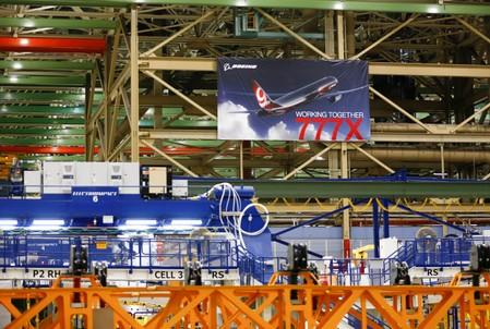 A large 777X banner is seen hanging over the Boeing 777X Final Assembly Building floor during a media tour of Boeing production facilities in Everett