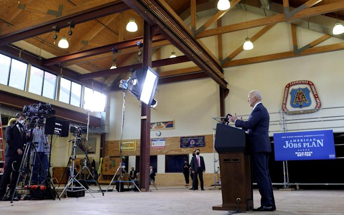 Joe Biden talks about a $ 2 trillion infrastructure plan during an event promoting the plan at the Carpenters Pittsburgh Training Center in Pittsburgh-Reuters