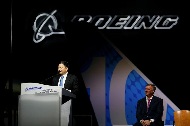 Singapore Airlines Chief Executive Goh Choon Phong speaks as Boeing Commercial Airplanes Chief Executive Kevin McAllister looks on during a delivery ceremony of the new Boeing 787-10 Dreamliner to Singapore Airlines at the Boeing South Carolina Plant in No