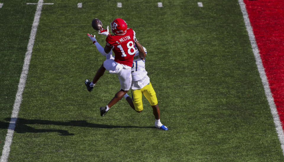 Rutgers wide receiver Bo Melton (18) beats Delaware defensive back Justis Henley (21) to catch a pass for a 28-yard touchdown during the first half of an NCAA college football game, Saturday, Sept. 18, 2021, in Piscataway, N.J. (Andrew Mills/NJ Advance Media via AP)