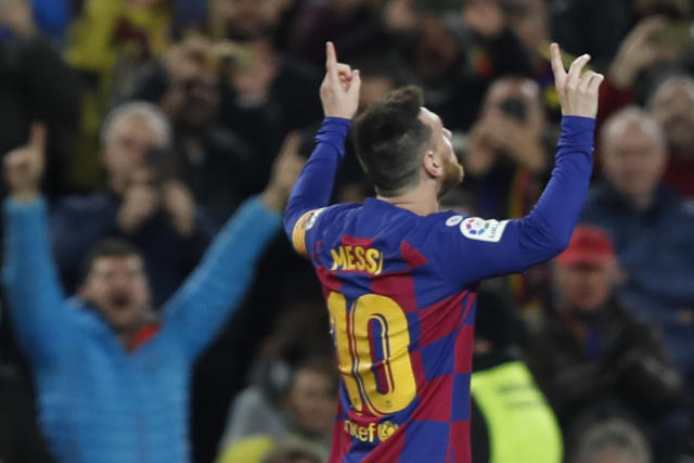 Barcelona's Lionel Messi celebrates after scoring a hat-trick and his side's third goal during a Spanish La Liga soccer match between Barcelona and Celta at Camp Nou stadium in Barcelona, Saturday, Nov. 9, 2019. (AP Photo/Joan Monfort)