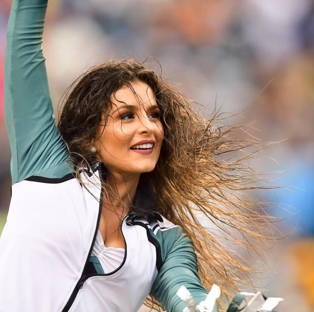 <p>An Eagles cheerleader performs in the rain during the NFL game between the San Francisco 49ers and the Philadelphia Eagles on October 29, 2017 at Lincoln Financial Field in Philadelphia PA. (Photo by Gavin Baker/Icon Sportswire via Getty Images) </p>