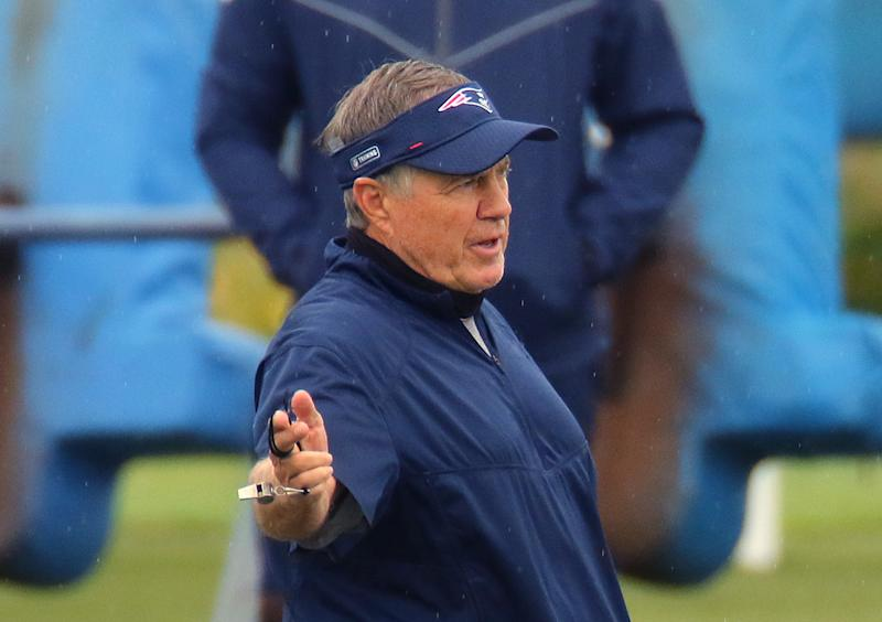 Bill Belichick, pictured at practice at Gillette Stadium in Foxborough, Mass., is entering his 21st season in New England. (Photo by John Tlumacki/The Boston Globe via Getty Images)