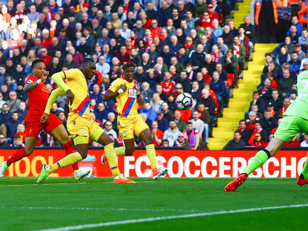 Christian Benteke scores his first goal against Liverpool for Crystal Palace: Getty