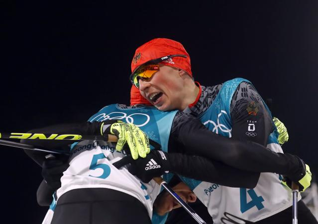 Nordic Combined Events - Pyeongchang 2018 Winter Olympics - Men's Individual 10 km Final - Alpensia Cross-Country Skiing Centre - Pyeongchang, South Korea - February 20, 2018 - Johannes Rydzek of Germany and Eric Frenzel of Germany react after crossing the finish line. REUTERS/Kai Pfaffenbach