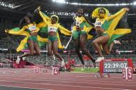 Team Jamaica celebrates after winning the final of the women's 4 x 100-meter relay at the 2020 Summer Olympics, Friday, Aug. 6, 2021, in Tokyo. (AP Photo/Petr David Josek)
