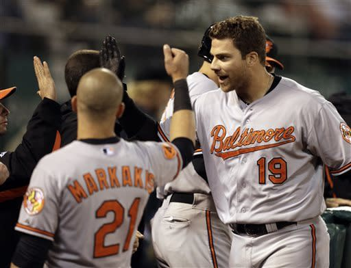 Baltimore Orioles' Chris Davis, right, is congratulated after hitting a home run off Oakland Athletics' Jarrod Parker in the sixth inning of a baseball game, Thursday, April 25, 2013, in Oakland, Calif. (AP Photo/Ben Margot)