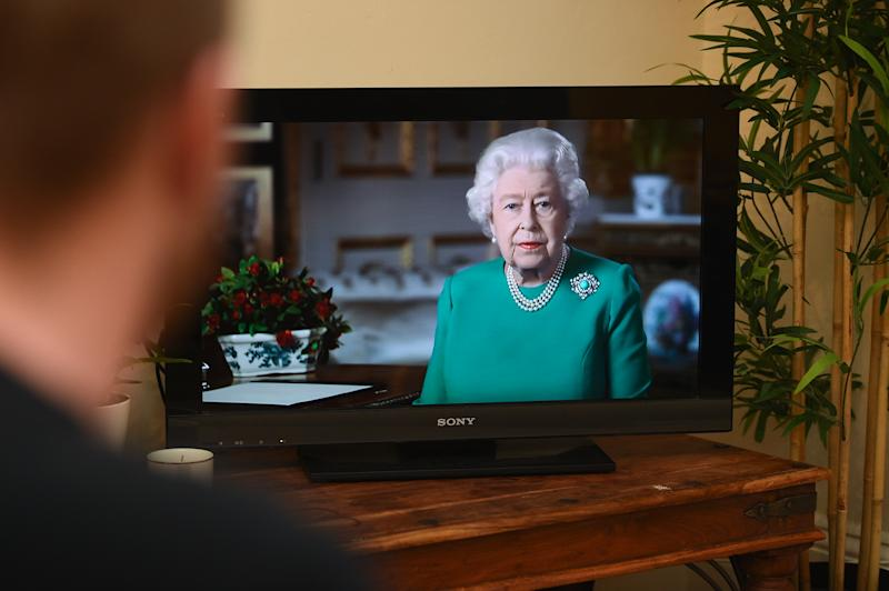 People in Wandsworth, London, watch Queen Elizabeth II deliver her address to the nation and the Commonwealth in relation to the coronavirus epidemic. (Photo by Kirsty O'Connor/PA Images via Getty Images)