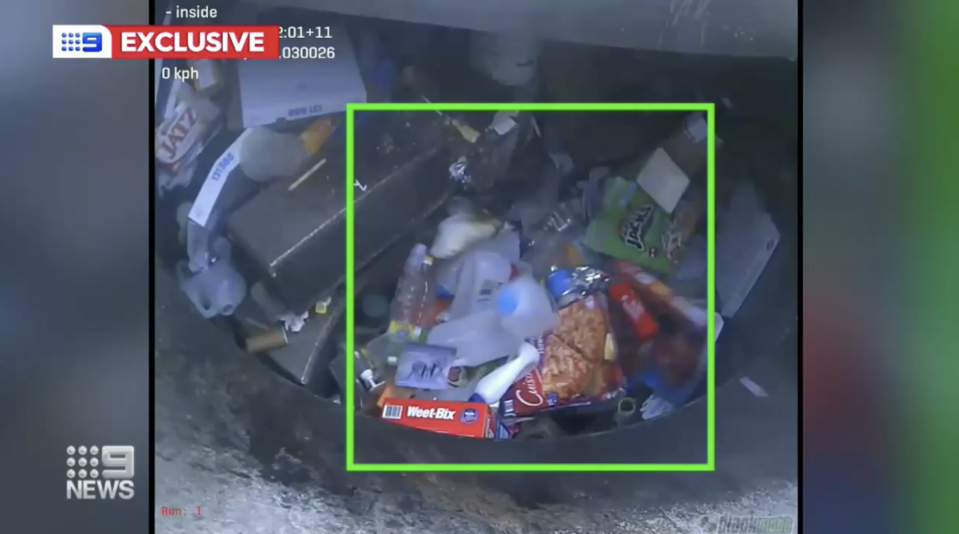 Pictured is a green square around recycling placed in a garbage truck.