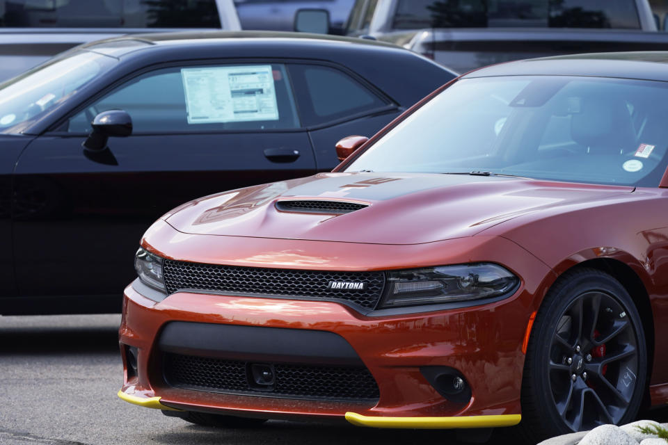 An unsold 2020 Charger sedan sits at a Dodge dealership, Sunday, Sept. 6, 2020, in Littleton, Colo. The best thing you can do for your car's value is to take care of it. (AP Photo/David Zalubowski)