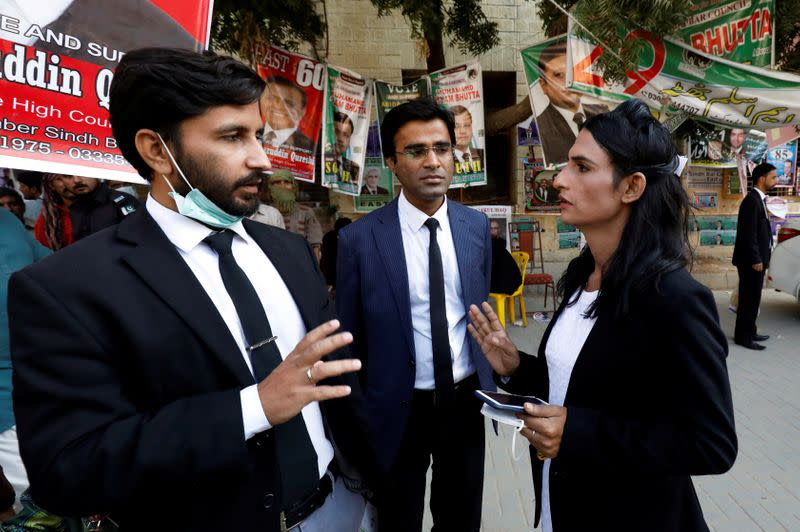 Nisha Rao, 28, a transgender woman who became country's first practicing lawyer, talks with her colleagues at district City Court in Karachi,