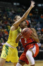 Arizona's Aarion McDonald (2) drives into Oregon's Maite Cazorla during the first half of an NCAA college basketball game at the Pac-12 women's tournament Friday, March 8, 2019, in Las Vegas. (AP Photo/John Locher)