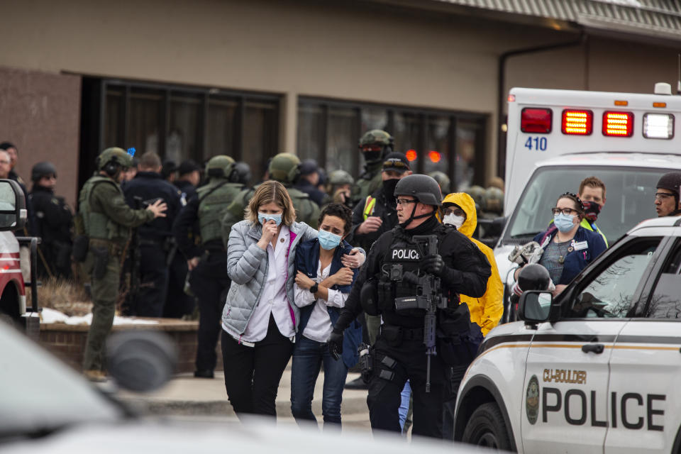 Healthcare workers walk out of a King Sooper's Grocery store after a gunman opened fire on March 22, 2021 in Boulder, Colorado. Source: Getty