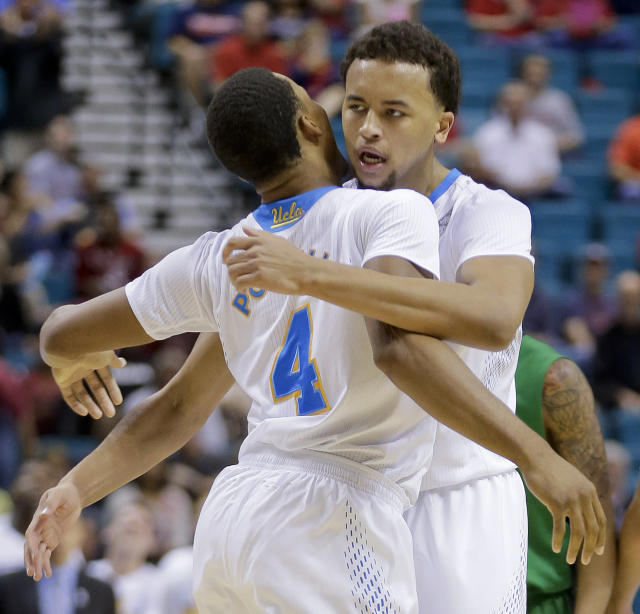 UCLA's Kyle Anderson, right, bumps chests with teammate Norman Powell (4) after scoring against Oregon in the first half of an NCAA Pac-12 conference tournament quarterfinal college basketball game on Thursday, March 13, 2014, in Las Vegas. (AP Photo/Julie Jacobson)