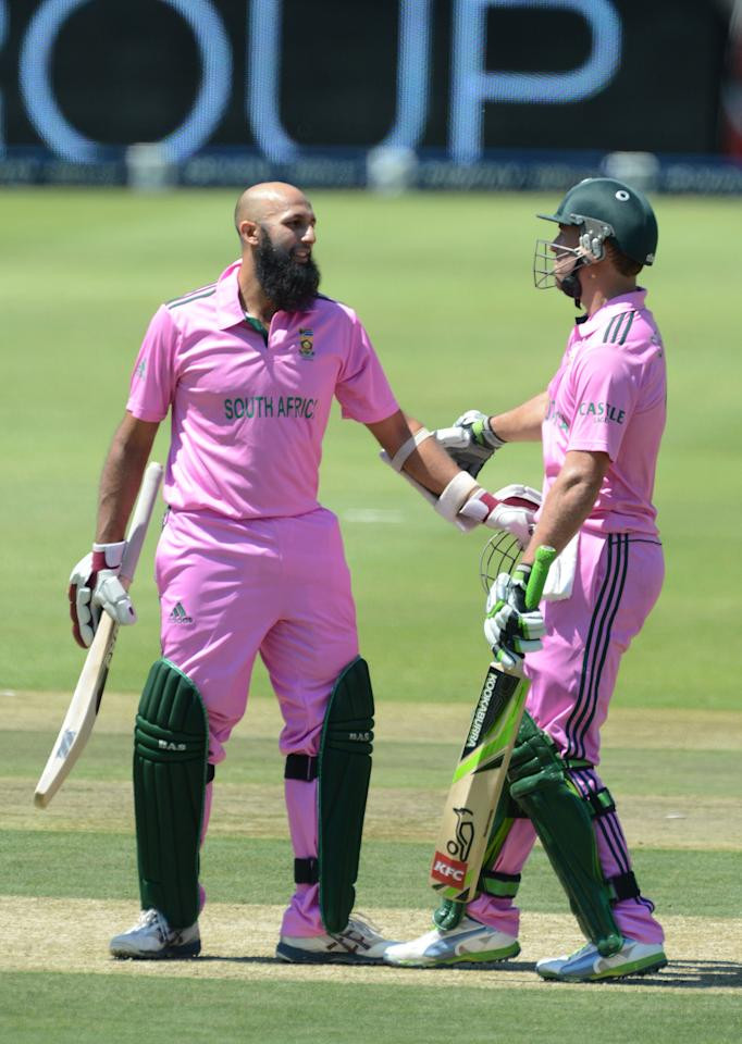JOHANNESBURG, SOUTH AFRICA - MARCH 17:  Hashim Amla of South Africa celebrates his 100 with AB de Villiers  during the 3rd Momentum ODI match between South Africa and Pakistan at Bidvest Wanderers Stadium on March 17, 2013 in Johannesburg, South Africa. (Photo by Duif du Toit/Gallo Images/Getty Images)
