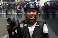 Associated Press (AP) photographer Thein Zaw posing for a photo during his coverage of demonstrations by protesters against the military coup in Yangon, a day before he was arrested