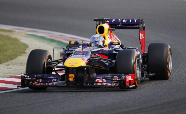 Red Bull Formula One driver Sebastian Vettel of Germany drives during the qualifying session of the Japanese F1 Grand Prix at the Suzuka circuit October 12, 2013. REUTERS/Issei Kato (JAPAN - Tags: SPORT MOTORSPORT F1)