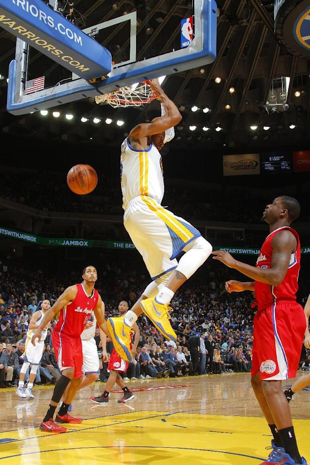 OAKLAND, CA - JANUARY 30: Andre Iguodala #9 of the Golden State Warriors dunks against the Los Angeles Clippers on January 30, 2014 at Oracle Arena in Oakland, California. (Photo by Rocky Widner/NBAE via Getty Images)