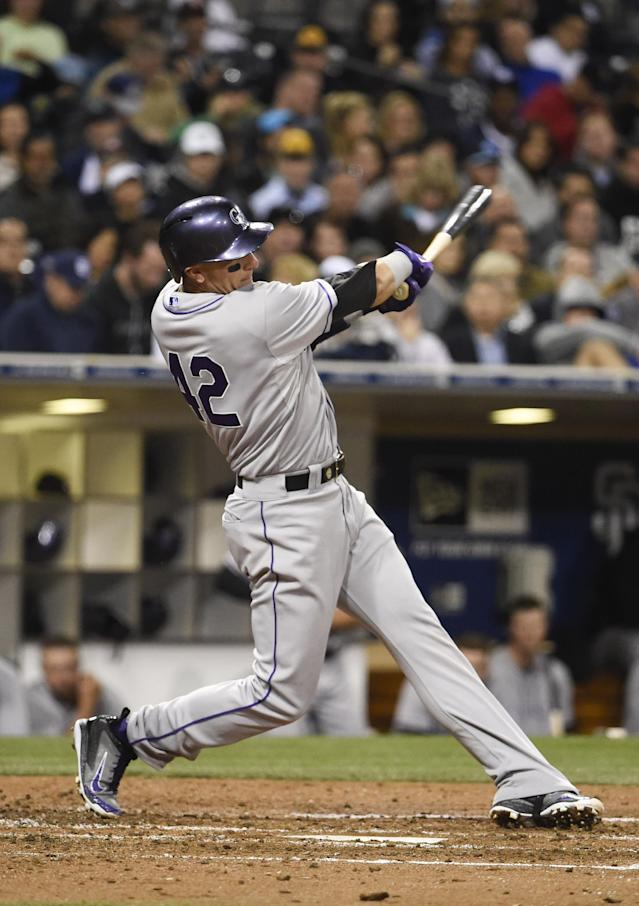SAN DIEGO, CA - APRIL 15: Troy Tulowitzki of the Colorado Rockies hits a double during the fourth inning of a baseball game against the San Diego Padres at Petco Park April 15, 2014 in San Diego, California. All uniformed team members are wearing jersey number 42 in honor of Jackie Robinson Day. (Photo by Denis Poroy/Getty Images)