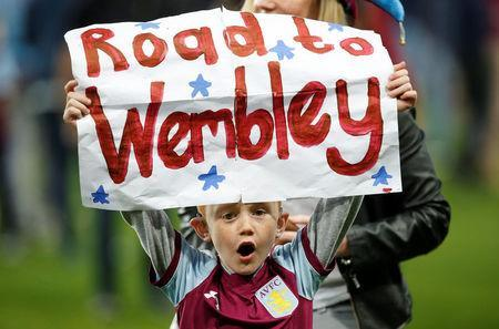 Soccer Football - Championship Play Off Semi Final Second Leg - Aston Villa v Middlesbrough - Villa Park, Birmingham, Britain - May 15, 2018 Aston Villa fan holds up a poster as he celebrates after the match Action Images via Reuters/Craig Brough
