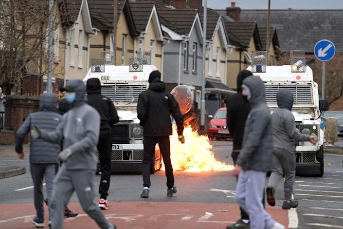 <p>Trouble has flared in Northern Ireland following Brexit. Nationalists (in image) attack Police on Springfield Road near Peace Wall in Belfast on 8 April</p> (Getty Images)