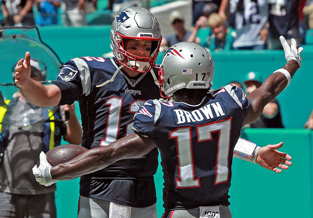 Tom Brady celebrates Antonio Brown's touchdown for the New England Patriots against the Miami Dolphins on Sept. 15, 2019. (Staff Photo By Matt Stone/MediaNews Group/Boston Herald)