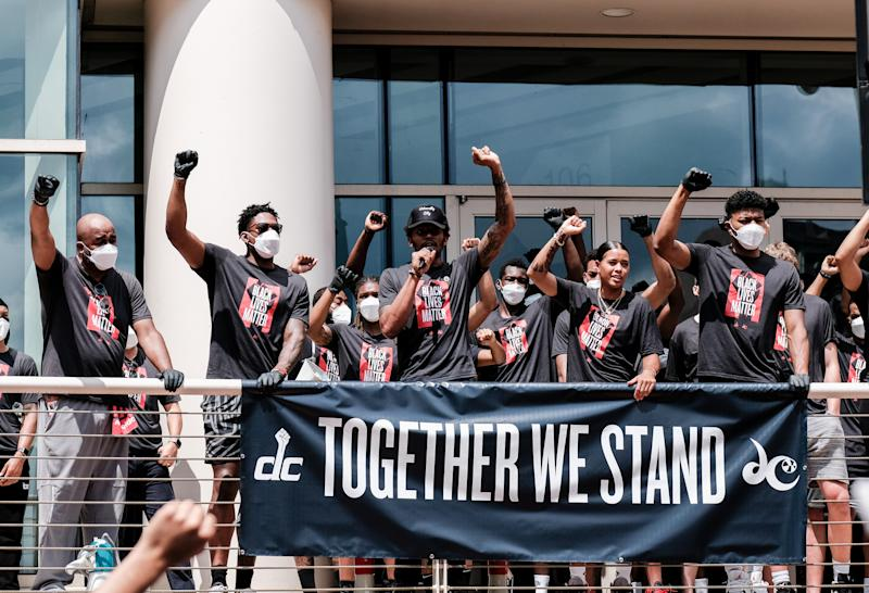 WASHINGTON, DC - JUNE 19: Members of the Washington Wizards and Washington Mystics basketball teams hold rally to mark the liberation of slavery on June 19, 2020 in Washington, DC. Juneteenth commemorates June 19, 1865, when a Union general read orders in Galveston, Texas stating all enslaved people in Texas were free according to federal law. (Photo by Michael A. McCoy/Getty Images)