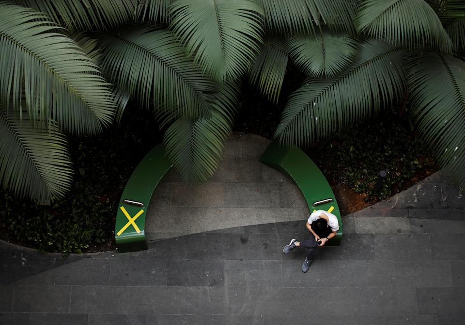 A man sits at a rest area at a mall during the coronavirus disease (COVID-19) outbreak, in Singapore, September 23, 2021. REUTERS/Edgar Su