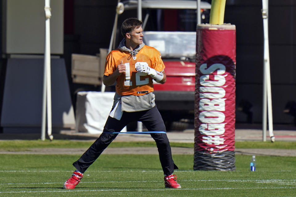 Tampa Bay Buccaneers quarterback Tom Brady (12) runs with an elastic band around his legs during an NFL football workout Thursday, Jan. 28, 2021, in Tampa, Fla. The Buccaneers play the Kansas City Chiefs in Super Bowl LV on Feb. 7. (AP Photo/Chris O'Meara)