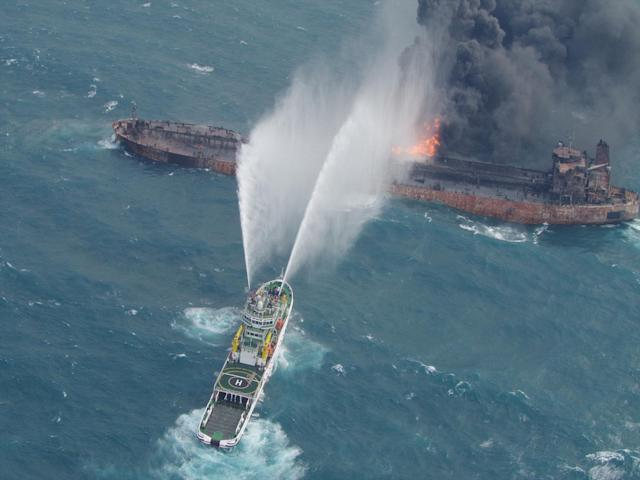 <p>A rescue ship works to extinguish the fire on the stricken Iranian oil tanker Sanchi in the East China Sea, on Jan. 10, 2018 in this photo provided by Japan's 10th Regional Coast Guard. (Photo: 10th Regional Coast Guard Headquarters/Handout via Reuters) </p>
