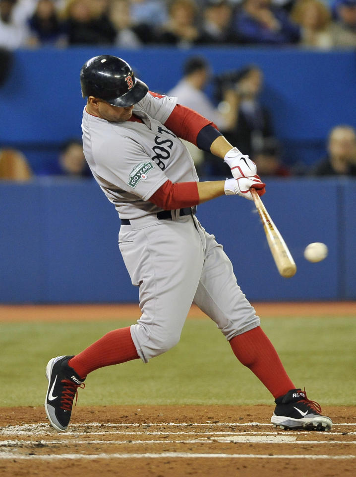 TORONTO, CANADA - APRIL 9:  Cody Ross #7 of the Boston Red Sox bats during MLB game action against the Toronto Blue Jays during the Home Opener on April 9, 2012 at Rogers Centre in Toronto, Ontario, Canada. (Photo by Brad White/Getty Images)