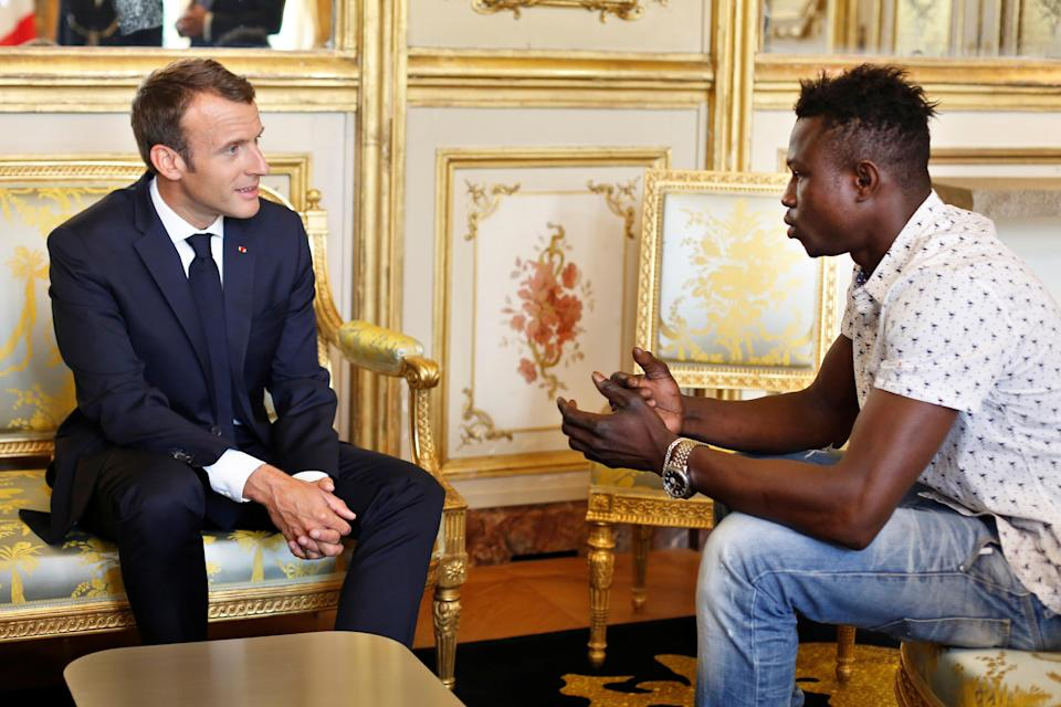 French President Emmanuel Macron meets with Mamoudou Gassama at the <span>Élysée</span> Palace in Paris on May 28, 2018. (Photo: Thibault Camus/Pool via Reuters)