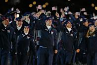 <p>Team USA looked cozy and warm in Roots apparel at the Salt Lake City Olympics, layering fleece zip-ups and track pants over light blue knits and white turtlenecks. </p>