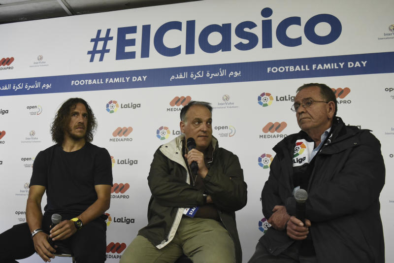 """Retired Spanish player and La Liga ambassador Carles Puyol, left, La Liga President Xavier Tebas, center, and Greece's Migration Minister, Yannis Mouzalas attend a news briefing in Thessaloniki, Greece, Sunday, April 23, 2017. About 1,000 refugees residing in northern Greece attended an event in the framework of """"Football Family Day"""" during which they watched a live broadcasting of Spanish first division soccer match between Barcelona and Real Madrid on two giant screens. (AP Photo/Giannis Papanikos)"""