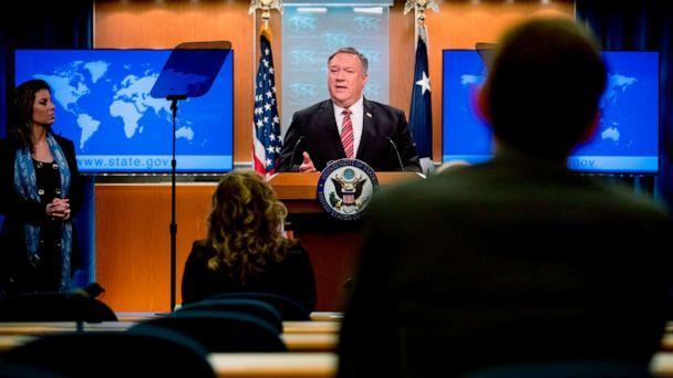 PHOTO: US Secretary of State Mike Pompeo, accompanied by State Department spokeswoman Morgan Ortagus(L) speaks at a news conference at the State Department on April 29, 2020, in Washington,DC. (Andrew Harnik/POOL/AFP via Getty Images)
