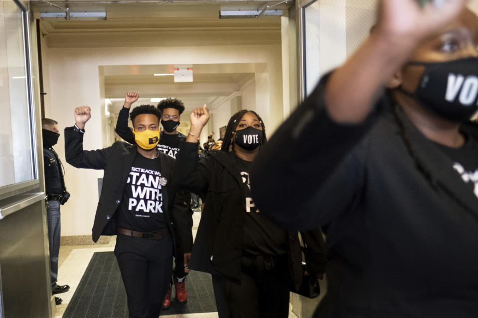 Supporters of Georgia State Rep. Park Cannon, D-Atlanta, leave the State Capitol in Atlanta on Monday morning, March 29, 2021 after escorting her into the building. Cannon was arrested last week for knocking on the governor's office door as he signed voting legislation. (AP Photo/Ben Gray)