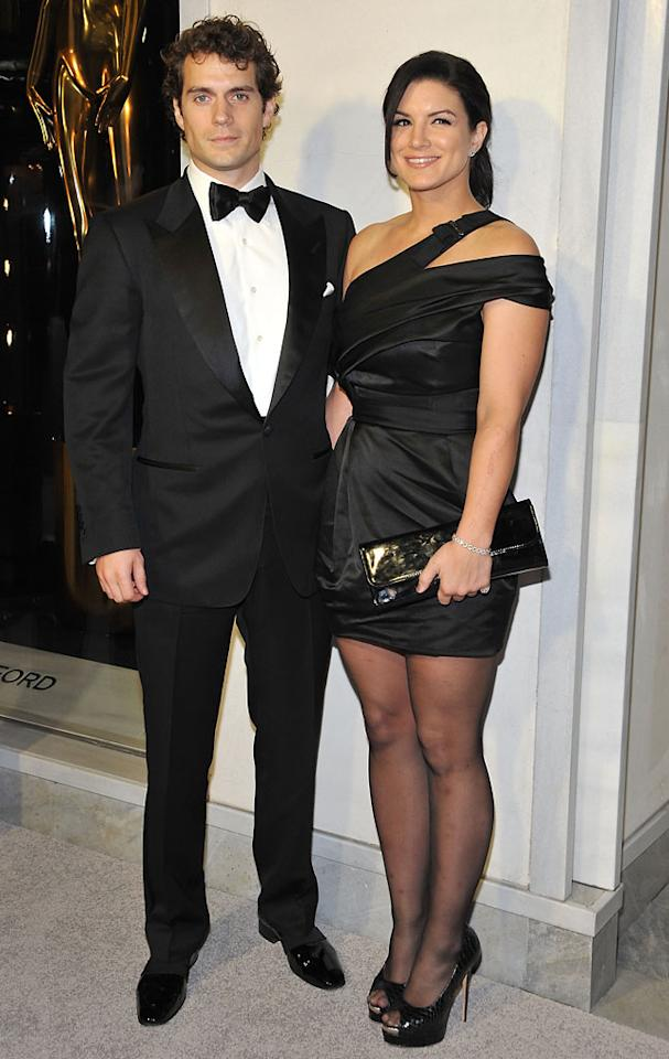 Henry Cavill and actress Gina Carano attend Tom Ford's cocktail event in support of Project Angel Food at TOM FORD on February 21, 2013 in Beverly Hills, California.