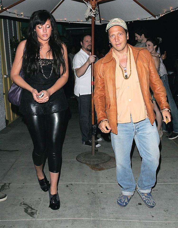 """For once, we'll let Rob Schneider off the hook. His girlfriend, on the other hand, should realize that latex leggings are beyond loathsome. <a href=""""http://www.infdaily.com"""" target=""""new"""">INFDaily.com</a> - June 27, 2008"""