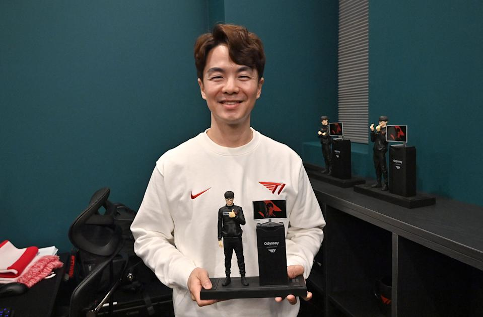 This picture taken on February 25, 2021 shows John Kim, chief operating officer of eSports organisation T1, posing with a figure of League of Legends giant Faker, during an interview with AFP at the T1 building in Seoul. - A Nike-sponsored gym, support staff including nutritionists, and English language classes are all part of the set-up at T1 where around 70 gamers are looking to emulate its highest-profile member, League of Legends giant Faker. - TO GO WITH AFP STORY SKOREA-ESPORTS-TECHNOLOGY-GAME-BUSINESS,FOCUS BY SUNGHEE HWANG (Photo by Jung Yeon-je / AFP) / TO GO WITH AFP STORY SKOREA-ESPORTS-TECHNOLOGY-GAME-BUSINESS,FOCUS BY SUNGHEE HWANG (Photo by JUNG YEON-JE/AFP via Getty Images)