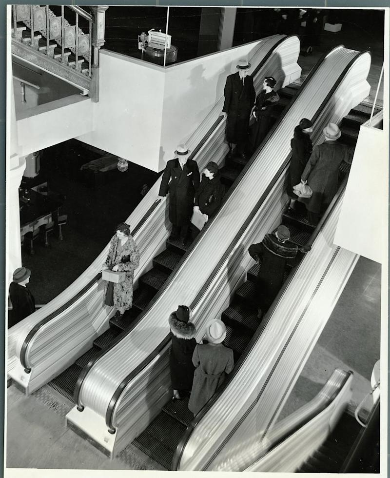 Shoppers on the escalators at the first Sears store in Chicago.