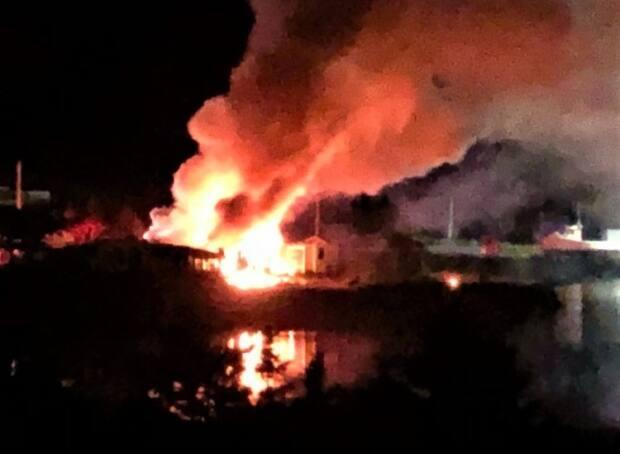 A fire on Wharf Road in East Tracadie, N.S., caused $150,000 in damage. (Nova Scotia RCMP - image credit)