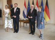 German president Frank-Walter Steinmeier, second right, and his wife Elke Buedenbender, right, welcome King Willem-Alexander of the Netherlands and Queen Maxima at the Bellevue palace in Berlin, Germany, Monday, July 5, 2021. The Royals arrived in Germany for a three-day visit that was delayed from last year because of the coronavirus pandemic. (Wolfgang Kumm/dpa via AP)