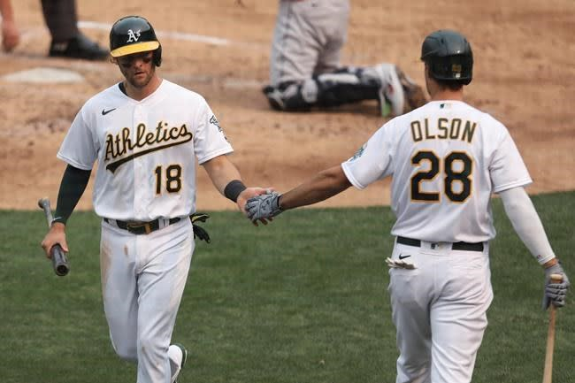Pinder plays through tender hamstring to help A's advance