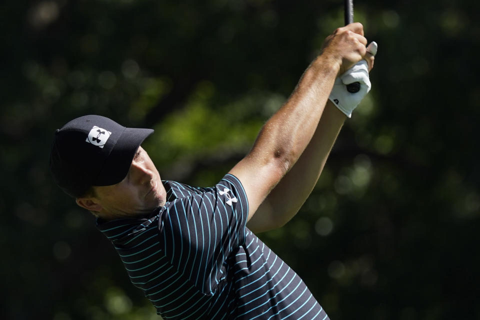 Jordan Spieth follows through on this tee shot on the third hole during the second round of the Charles Schwab Challenge golf tournament at the Colonial Country Club in Fort Worth, Texas, Friday, June 12, 2020. (AP Photo/David J. Phillip)