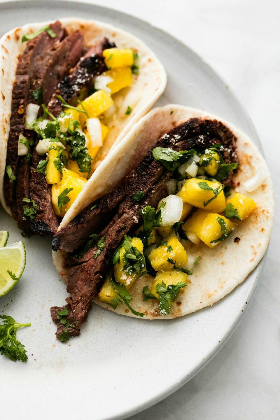 """<p>Everything is better when it's a taco.</p><p>Get the recipe from <a href=""""/cooking/recipe-ideas/recipes/a52048/jamaican-jerk-steak-tacos-recipe/"""" data-ylk=""""slk:Delish"""" class=""""link rapid-noclick-resp"""">Delish</a>.</p>"""
