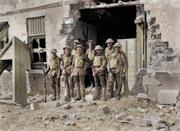 <p>8 British soldiers outside of a destroyed building (Royston Leonard / Media Drum World / Caters News) </p>