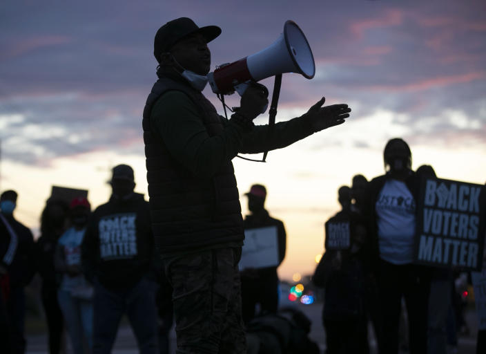 Tony Riddick addresses demonstrators at the intersection of Ehringhaus Street and Road Street during a march on Friday, April 23, 2021 in Elizabeth City, N.C. Several days of protests followed the shooting death of Andrew Brown Jr. on Wednesday by sheriff's deputies serving drug-related search and arrest warrants. (Robert Willett/The News & Observer via AP)