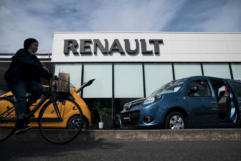 TSUKUBA, JAPAN - MAY 27: A woman rides a bicycle past a dealership for Nissan Motor Co. and Renault SA on May 27, 2020 in Tsukuba, Japan. Nissan and Renault unveiled a revised mid-term business plan today. (Photo by Tomohiro Ohsumi/Getty Images) (Photo: Tomohiro Ohsumi via Getty Images)